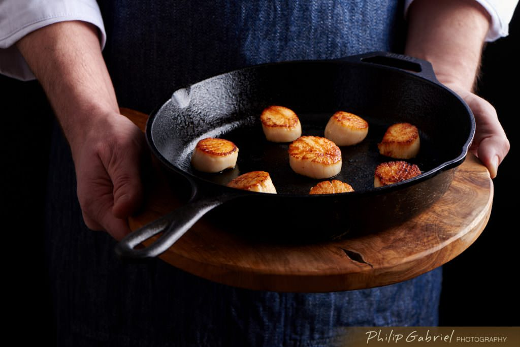 Food Dark Lifestyle Chef Holding Scallops on Cast Iron Styled Photographed by Philip Gabriel Photography