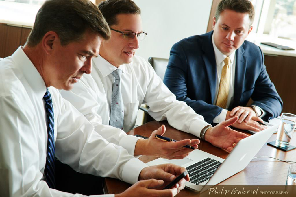 Corporate office meeting space three men working Photographed by Philip Gabriel Photography