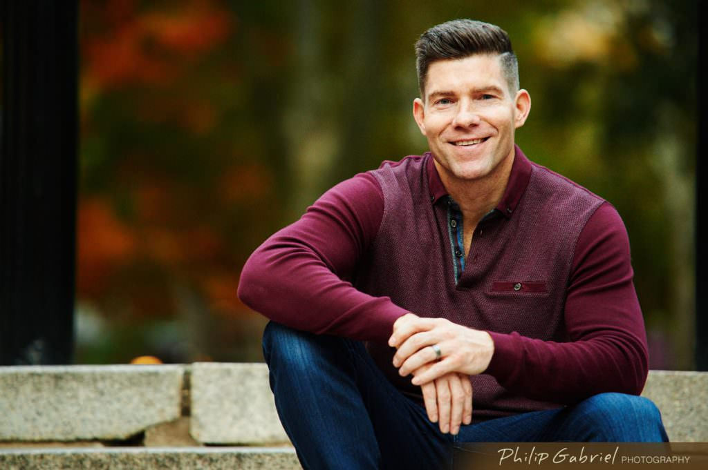 Headshot man outdoors of steps Photographed by Philip Gabriel Photography