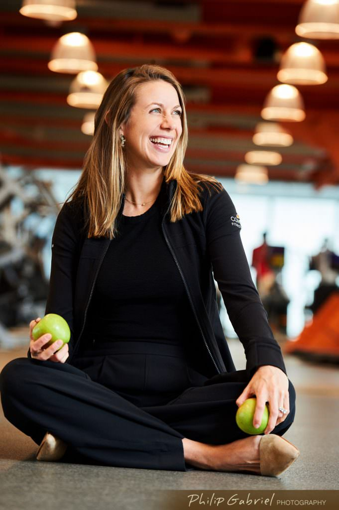 Health and Wellness Fitness Trainer Comcast center holding two apples Photographed by Philip Gabriel Photography
