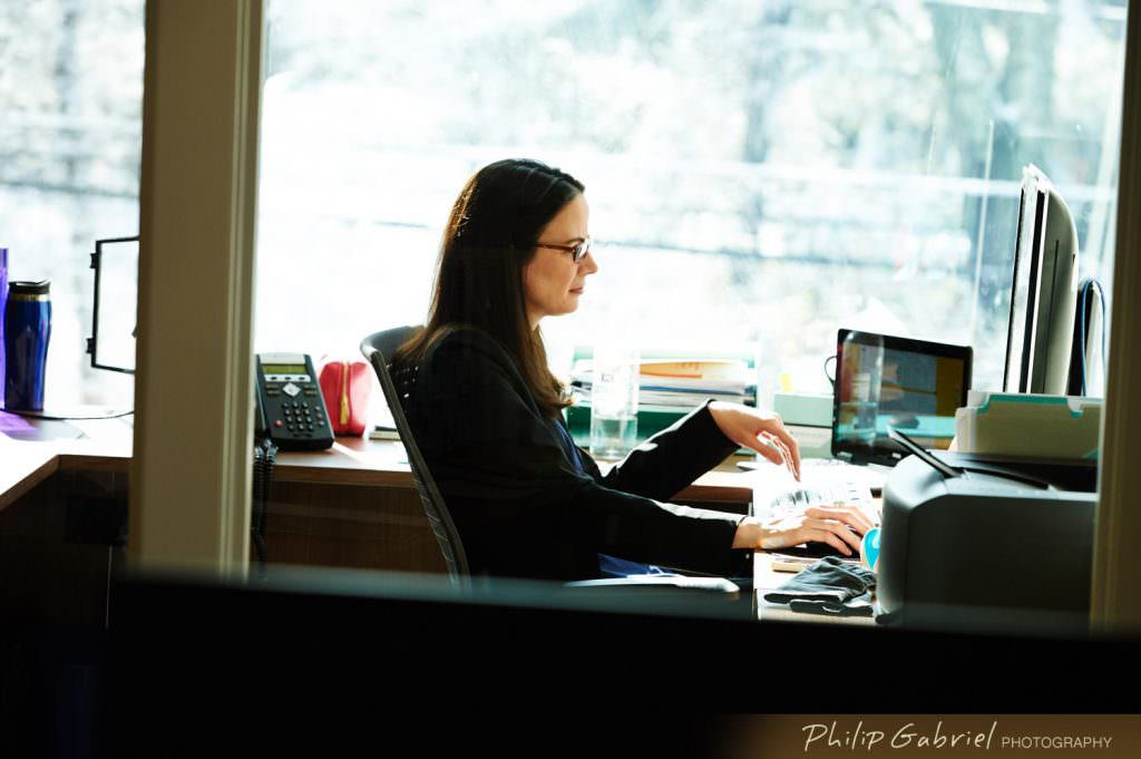 Corporate office space business woman working Photographed by Philip Gabriel Photography