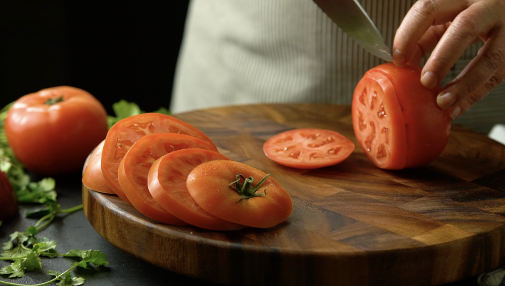Food Lifestyle Chef Cutting Tomato on Cutting Board Styled Photographed by Philip Gabriel Photography